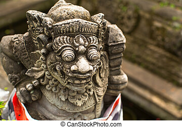 Traditional demon guard statue carved in stone, Bali island,...