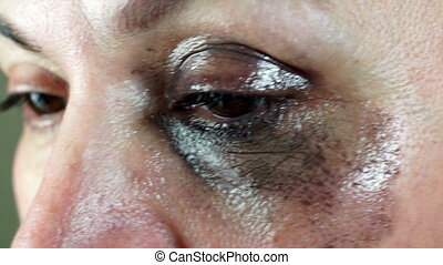 Woman Removing Eye Makeup Closeup - Closeup shot of a middle...