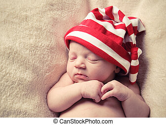 Christmas baby sleeping - A newborn baby sleeping soundly...
