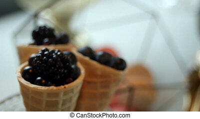 black BlackBerry in a waffle cone with chocolate filling...