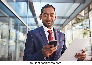 Multi tasking and the modern businessman - Confident and...