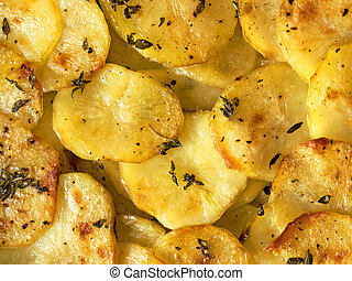 rustic french golden anna potato - close up of rustic french...