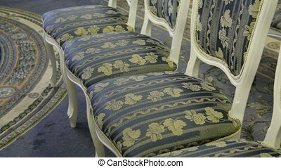 bright chairs in the art Nouveau style in the great hall of...