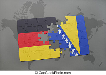 puzzle with the national flag of germany and bosnia and...