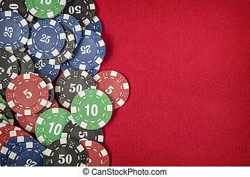 Gambling chips for poker on red felt background