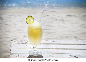 Tropical cocktail with rum on beautiful sunny beach