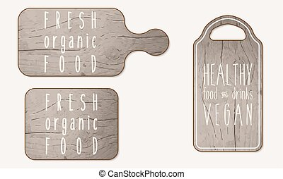 Wooden breadboard with the words healthy, organic, food