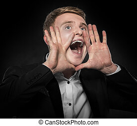 Businessman in black suit shouts lifting his hands up. on a...