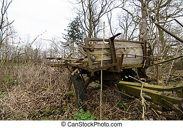 old tractor trailer in nature