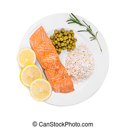 Fried salmon fillet on plate with lemon and rice