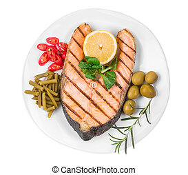 Fried salmon fillet on plate. Isolated on a white...