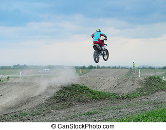 biker making a stunt and jumps in the air - athlete in...