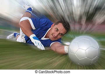 Goalkeeper Save - Goalkeeper diving to stop the soccer ball...