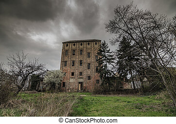 high abandoned factory with storm clouds