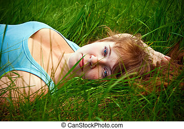 Woman Lying On A Grass - portrait of a beautiful female...