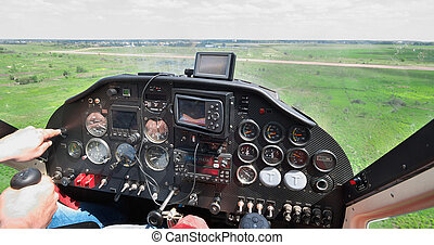 Light plane landing on the rough airstrip - view from the...