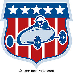 american Soap box derby car with stars and stripes in the background.