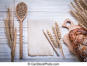 Collection of carving board wheat-rye ears baked bread stick...