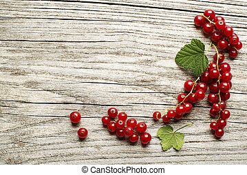 Currant - Red currant berries on a wooden table