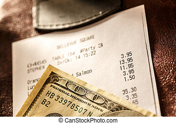 Cafe paper cheque with dollars in closeup