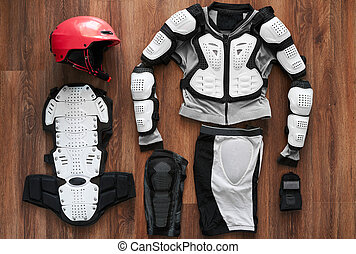 protective clothing and a helmet on wooden floor -...