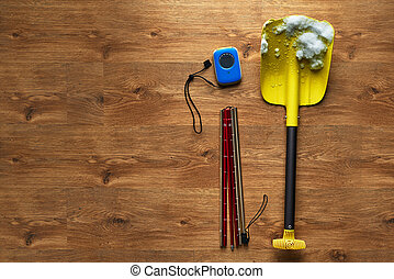avalanche rescue kit, lying on wooden floor. - avalanche...