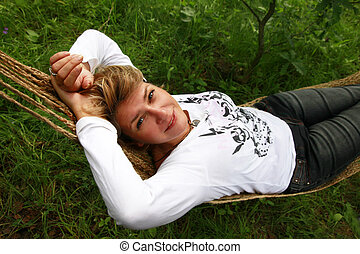 Woman in a hammock - The woman enjoys laying in a hammock