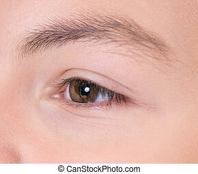 Boy with brown eyes - Close-up of boy with brown eyes...
