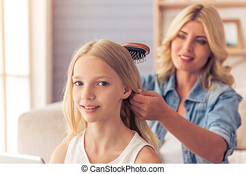 Mom and daughter - Attractive teenage girl is looking at...