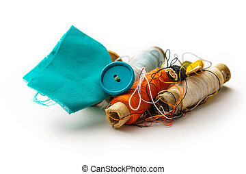 Sewing items with thread bobbins on white