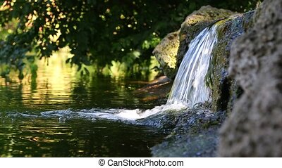 Small waterfall in a park - Small waterfall in the shadow