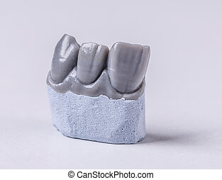 Artificial tooth, wax model on white background