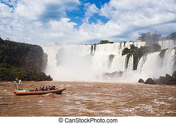 tourist boat at Iguazu falls cascades at Argentina