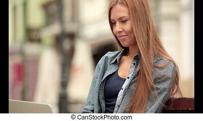 Young stylish woman with a laptop - Young stylish woman with...