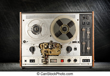 Old reel tape recorder on steel background