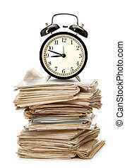 Stack of old papers and alarm clock - Stack of old paper...