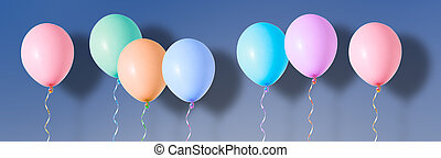 Multicoloured air flying balloons on blue background