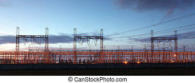 distribution substation silhouetted against dusk sky ,electricity background