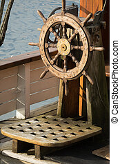 Ship steering wheel - Wooden steering wheel on an old ship