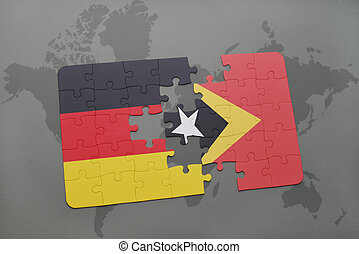 puzzle with the national flag of germany and east timor on a world map background.