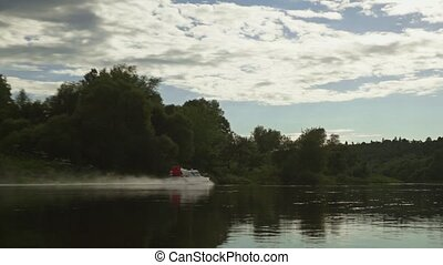 Hovercraft gliding on river surface slow motion zoom in shot