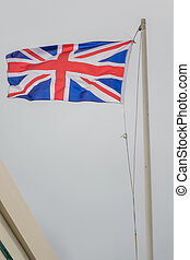 British flag - British flat on a mast fluttering in a strong...