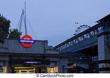 Embakment metro station at twilight in London, with...