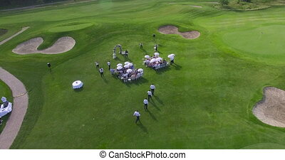 People on the golf course aerial view