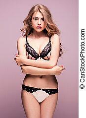 Sexy girl in lingerie posing in studio.