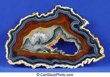 Agate - A cross section of the agate stone with geode on the...