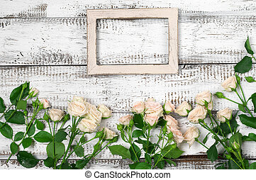 Wooden frame with roses - Empty vintage wooden photo frame...