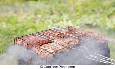 Barbequed meats are roasted on the grill