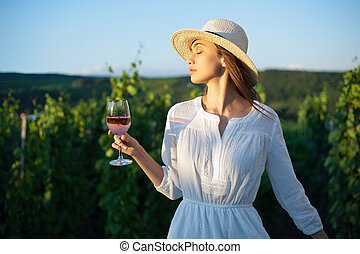Young brunette beauty in the vineyards.