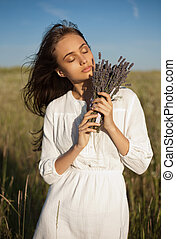The lavender girl - Outdoors portrait of a gorgeous young...